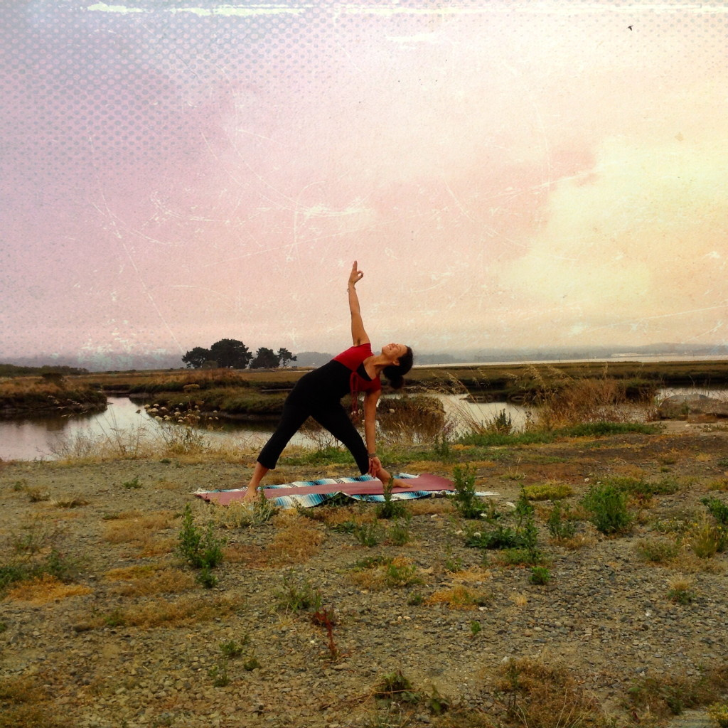 Trikonasana in marsh sunrise